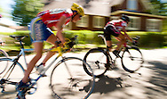 Female athletes competing in a bike criterion race in North Boulder Park in Boulder, Colorado