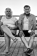 POINT PLEASANT, NJ - July 23:  A couple sit at Jenkinson's Boardwalk on July 23, 2015 in POINT PLEASANT, NJ.  (Photo by Michael Bocchieri/Bocchieri Archive)