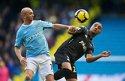 MANCHESTER, ENGLAND - Sunday, January 31, 2010: Manchester City Stephen Ireland and Portsmouth's Kevin Boateng during the Premiership match at the City of Manchester Stadium. (Photo by David Rawcliffe/Propaganda)