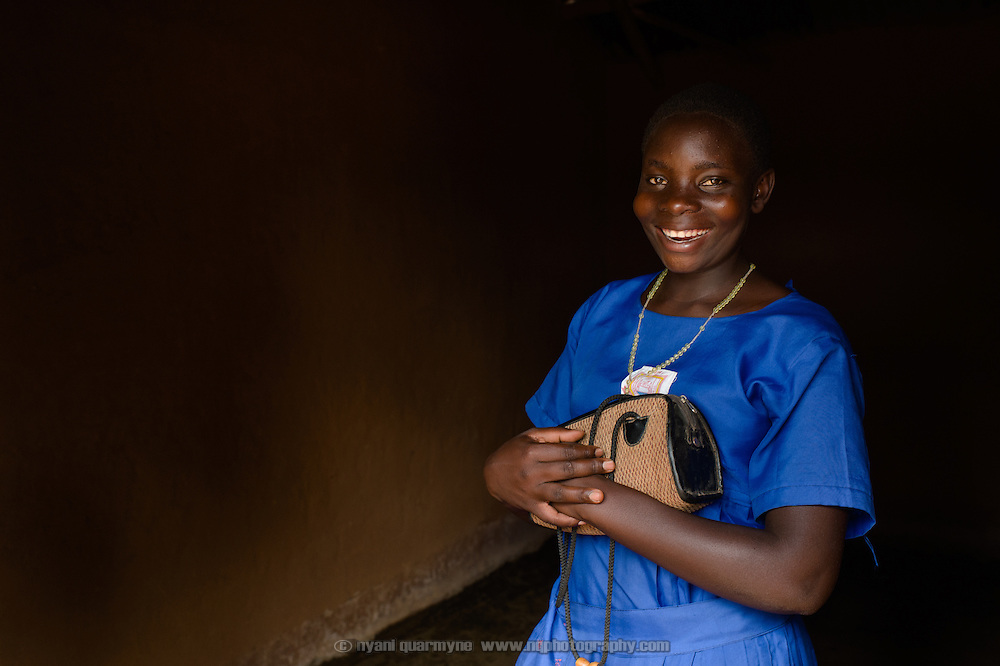 """Florence Amoit keeps her Afripads in a handbag hanging on the wall at her home near Tororo in Eastern Uganda. A student at Aputiri Primary School, which participates in a Menstrual Hygiene Management program supported by Plan International, Florence says she has been using Afripads for about a year, and says they are better than cotton wool because they don't leak. """"I used not to go to school because the blood would come out. But I'm now OK."""""""