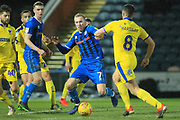 Stephen Dooley brings the ball forward during the EFL Sky Bet League 1 match between Rochdale and AFC Wimbledon at Spotland, Rochdale, England on 19 February 2019.