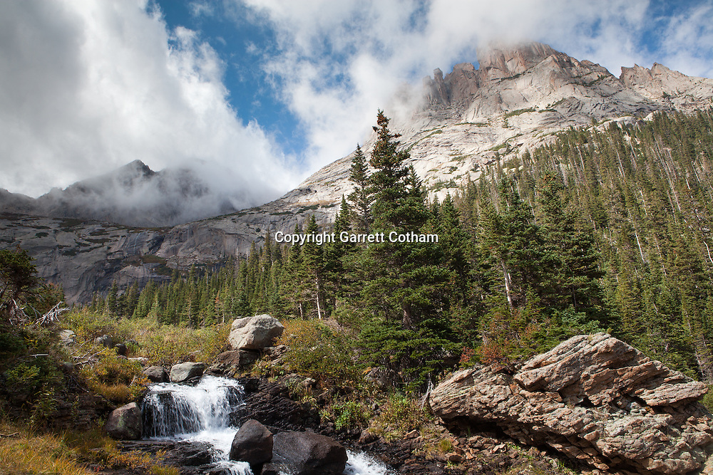 The outlet of Bear Lake flows through the canyon beneath the towering peaks of Rocky Mountain National Park.