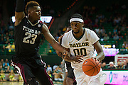 WACO, TX - DECEMBER 9: Royce O'Neale #00 of the Baylor Bears drives to the basket against the Texas A&M Aggies on December 9, 2014 at the Ferrell Center in Waco, Texas.  (Photo by Cooper Neill/Getty Images) *** Local Caption *** Royce O'Neale