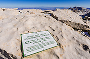 The summit plaque on Mount Whitney, Sequoia National Park, Sierra Nevada Mountains, California USA