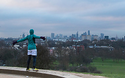 Primrose Hill, London, February 15th 2015. A man exercises on a chilly early morning on Primrose Hill, overlooking London&rsquo;s skyline.<br /> ///FOR LICENCING CONTACT: paul@pauldaveycreative.co.uk TEL:+44 (0) 7966 016 296 or +44 (0) 20 8969 6875. &copy;2015 Paul R Davey. All rights reserved.