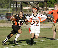 Senior Amy Green (12) tries to stay away from junior Sam Harp (22) during the 3rd Annual Powderpuff Challenge, the junior girls (class of 2008) against the senior girls (class of 2007.)