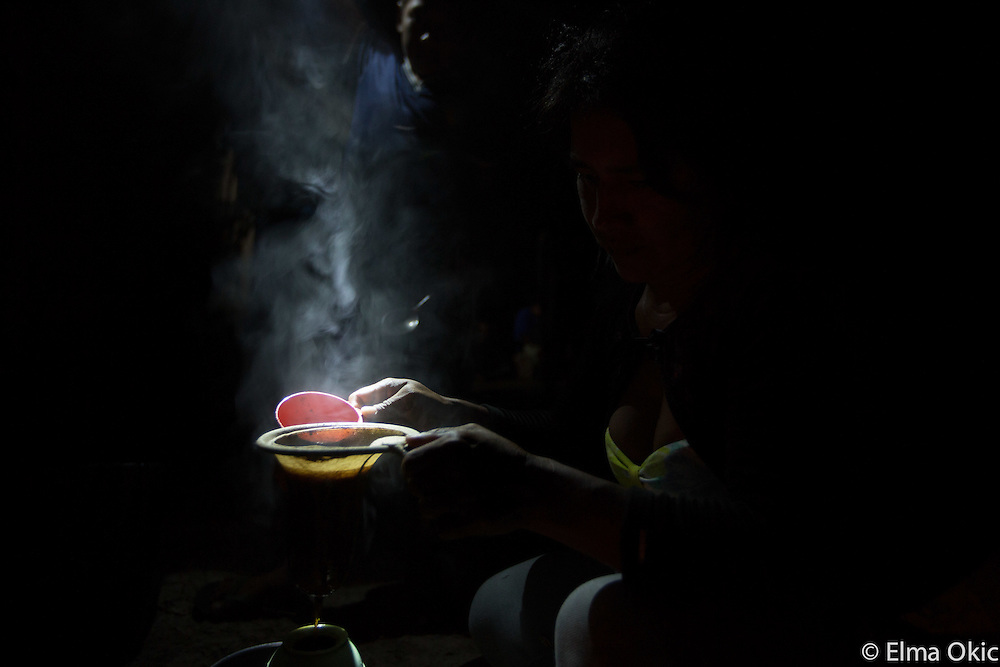 The 'bread and butter' of the people of the forest: coffee! Here it is being prepared at a remote camp, after dinner, following an the exhausting Munduruku palm leaf cutting expedition  on the Tapajos River, Para, Brazil. The palm leaves are used as roof covering for people's houses and dwellings.