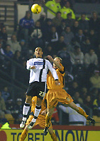 Photo: Dave Linney.<br />Derby County v Wolverhampton Wanderers. Coca Cola Championship. 18/11/2005.Marcus Tudgay (Derby) in an aerial dual with Jody Craddock(Wolves)