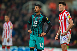 STOKE-ON-TRENT, ENGLAND - Saturday, January 25, 2020: Swansea City's Rhian Brewster (L) and Stoke City's Danny Batth during the Football League Championship match between Stoke City FC and Swansea City FC at the Britannia Stadium. (Pic by David Rawcliffe/Propaganda)