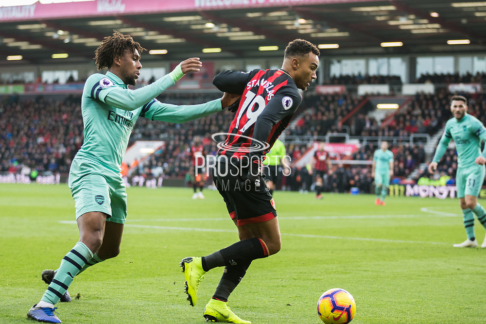 Mohamed Elneny (Arsenal) catching up to Junior Stanislas (Bournemouth) who has the ball during the Premier League match between Bournemouth and Arsenal at the Vitality Stadium, Bournemouth, England on 25 November 2018.