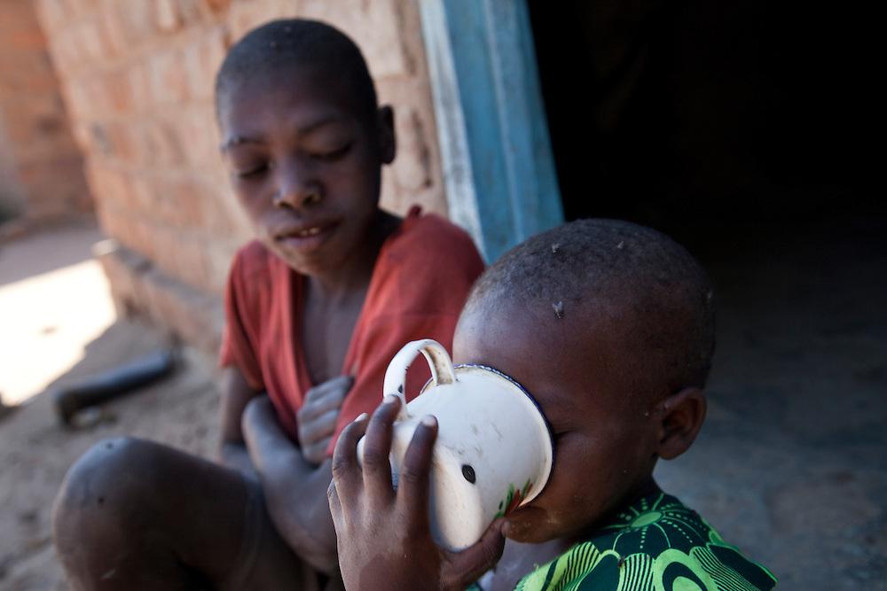 Eless Hamweene, and her sons Dexter and Define. Habeenzu village, Zambia.