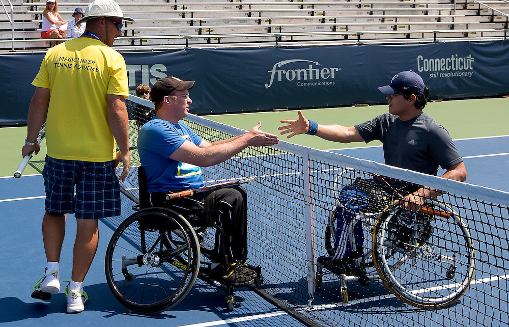August 20, 2014, New Haven, CT:<br /> Guests participate in an adaptive tennis clinic on day six of the 2014 Connecticut Open at the Yale University Tennis Center in New Haven, Connecticut Tuesday, August 19, 2014.<br /> (Photo by Billie Weiss/Connecticut Open)