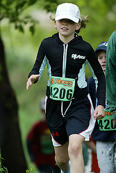 "(Kingston, Ontario---16/05/09) ""Rhiannon Murphy running in the kids race at the 2009 Salomon 5 Peaks Trail Running series Race held in Kingston, Ontario as part of the Eastern Ontario/Quebec division. ""  Copyright photograph Sean Burges / Mundo Sport Images, 2009. www.mundosportimages.com / www.msievents.com."