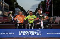 Arkiadisz Skrzpinski (GRE) (third), Rafal Wilk (POL) (first) and Mark Allen (GBR) (third on tyhe podium for the winners of The Prudential RideLondon Handcycle Grand Prix. Saturday 28th July 2018<br /> <br /> Photo: Ian Walton for Prudential RideLondon<br /> <br /> Prudential RideLondon is the world's greatest festival of cycling, involving 100,000+ cyclists - from Olympic champions to a free family fun ride - riding in events over closed roads in London and Surrey over the weekend of 28th and 29th July 2018<br /> <br /> See www.PrudentialRideLondon.co.uk for more.<br /> <br /> For further information: media@londonmarathonevents.co.uk