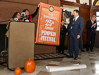 Karmen Gifford Lakes Region Chamber of Commerce, Ruth Sterling Let it Shine and Mayor Ed Engler share the official announcement that Laconia will host the 25th anniversary New Hampshire Pumpkin Festival during Friday afternoons press conference at the Laconia Train Station.  (Karen Bobotas/for the Laconia Daily Sun)