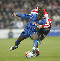 Photo: Aidan Ellis.<br /> Lincoln City v Grimsby Town. Coca Cola League 2, Play off Semi Final. 13/05/2006.<br /> Lincoln's Nat Brown challenges Grimsby's Gary Cohen