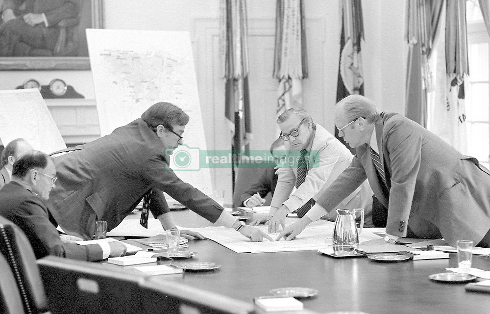 Gerald Ford, the 38th President of the United States, dies at 93, his wife Betty announced in a short statement on December 27, 2006. File Picture from the President's Library. Original Caption : CIA Director George Bush discusses the evacuation of Americans from Beirut with President Ford during a meeting of the National Security Council in the Cabinet Room. June 17, 1976. Photo Gerald R Ford Library via ABACAPRESS.COM
