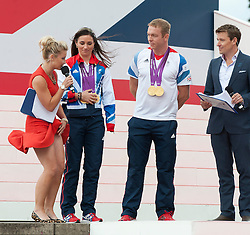 Presenter Helen Skelton loses her skirt when interviewing medallists Sarah Storey and Sir Chris Hoy at the Olympic and Paralympic parade outside the Queen Victoria Memorial, Monday September 10, 2012 .Photo Andrew Parsons/i-Images