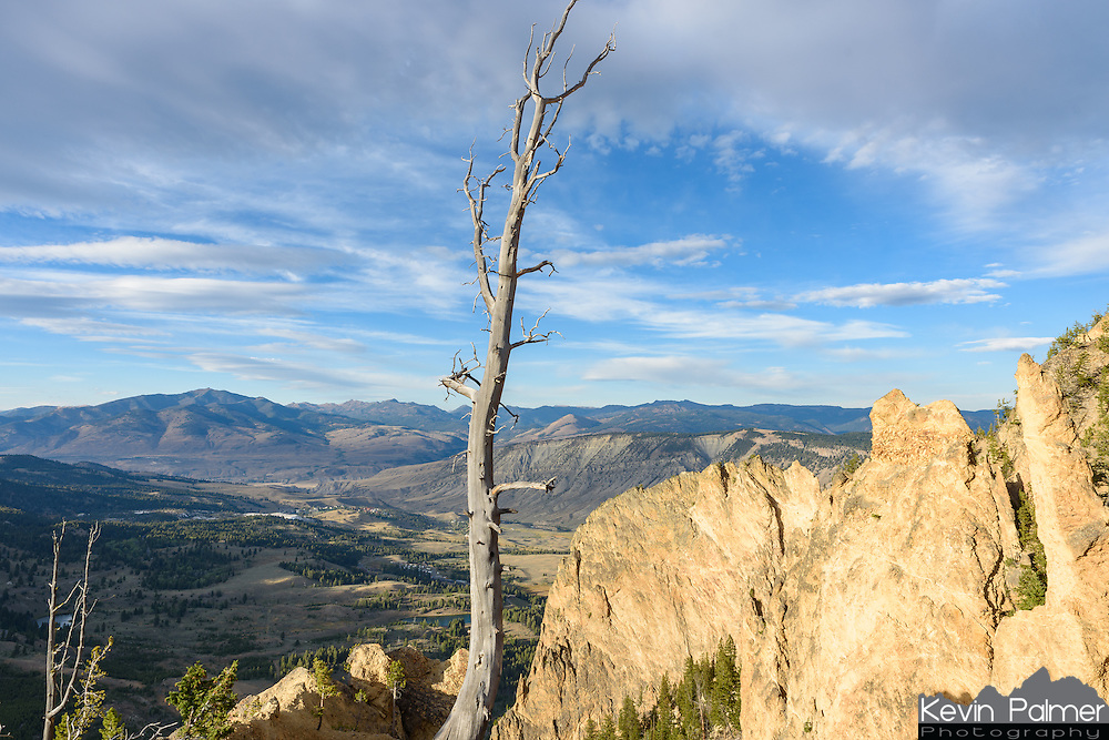 Cathedral Rock is locatred halfway up Bunsen Peak in Yellowstone National Park. Mammoth Hot Springs can be seen in the distance.
