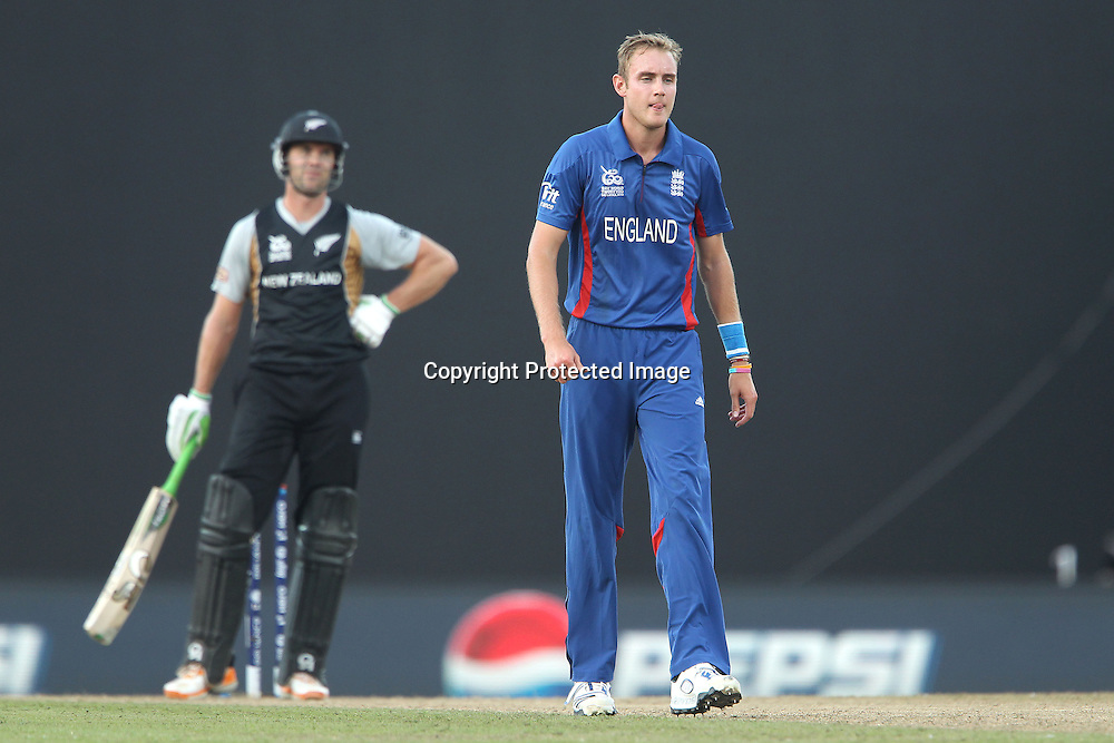 James Franklin reacts after dealing with a high delivery from Stuart Broad (Captain) of England as Broad walks back during the ICC World Twenty20 Super 8s match between England and New Zealand held at the  Pallekele Stadium in Kandy, Sri Lanka on the 29th September 2012<br /> <br /> Photo byRon Gaunt/SPORTZPICS/PHOTOSPORT