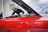 Sarah Marossy details the engine bay of her 1966 Mustang GT350 at her garage in Coeur d'Alene. Marossy grew up working on cars alongside her father and her passion for Mustangs has grown to a collection of the muscle cars.