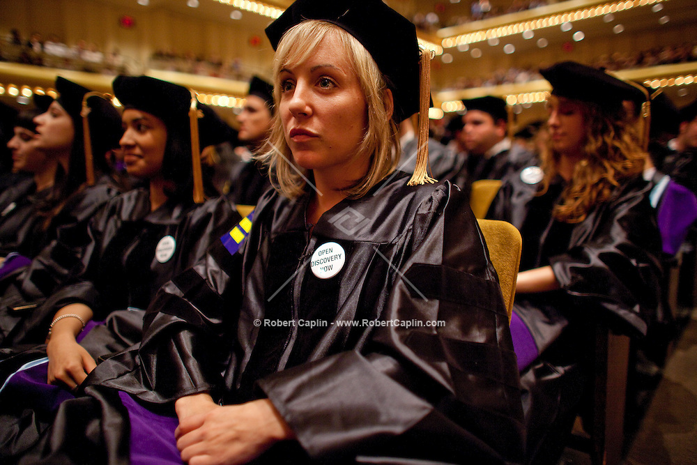 "Cardozo School of Law graduates wear ""Open Discovery Now"" pins during their commencement at Avery Fisher Hall in Lincoln Center...Photo by Robert Caplin ."