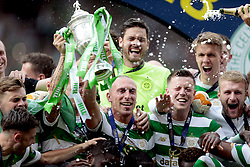 Celtic's Scott Brown (centre) lifts the trophy after winning the William Hill Scottish Cup Final at Hampden Park, Glasgow.