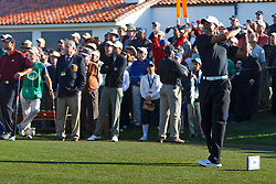 Feb 10, 2012; Pebble Beach CA, USA;  Tiger Woods hits his tee shot on the first hole during the second round of the AT&T Pebble Beach Pro-Am at Monterey Peninsula Country Club. Mandatory Credit: Jason O. Watson-US PRESSWIRE