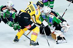 Daniel Nageler (UPC Vienna Capitals, #16) vs Jean-Philippe Lamoureux (HDD Tilia Olimpija, #1) during of ice-hockey match between HDD Tilia Olimpija and UPC Vienna Capitals in 8th Round of EBEL league, on October 2, 2011 at Hala Tivoli, Ljubljana, Slovenia. (Photo By Matic Klansek Velej / Sportida)