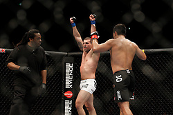 October 24, 2009; Los Angeles, CA; USA; Lyoto Machida (black trunks) watches Mauricio Rua(white trunks) raise his hands in celebration after their UFC light heavyweight championship bout at UFC 104.   Machida won via controversial unanimous decison .  Mandatory Credit:  Ed Mulholland