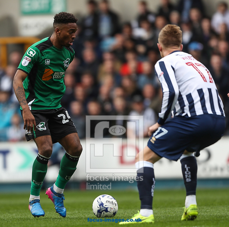 Ivan Toney of Scunthorpe United (left) and Byron Webster of Millwall in action during the Sky Bet League 1 match at The Den, London<br /> Picture by Toyin Oshodi/Focus Images Ltd 07984788195<br /> 01/04/2017
