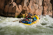 Rafting the Colorado River through the Grand Canyon in Arizona. Boatman Amy Martin is on the oars.