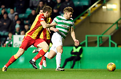 Celtic's Stuart Armstrong and Partick's Niall Keown battle for the ball during the Scottish Premiership match at Celtic Park, Glasgow.