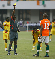Photo: Steve Bond/Richard Lane Photography.<br />Ivory Coast v Benin. Africa Cup of Nations. 25/01/2008. Abdouleye Meite (R) is booked by ref Marange Kenias