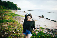 A young woman at a hidden beach along Guam's western shore.