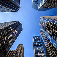 Photo of Chicago skyscrapers and office buildings looking upward toward the sky.
