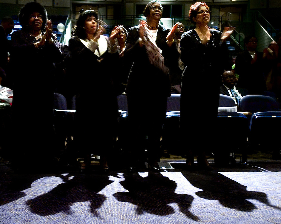 Attendees of the Dr. Martin Luther King, Jr. Scholarship Service stand in praise as the Unity Mass Choir sings, Sunday, January 20, 2008. .John Pavoncello photo