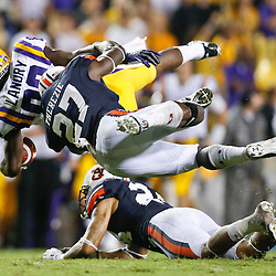 Sep 21, 2013; Baton Rouge, LA, USA; Auburn Tigers defensive back Robenson Therezie (27) tackles LSU Tigers wide receiver Jarvis Landry (80) during the second half of a game at Tiger Stadium. LSU defeated Auburn 35-21. Mandatory Credit: Derick E. Hingle-USA TODAY Sports
