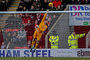 York City goalkeeper Scott Flinders watches it onto the bar  during the Sky Bet League 2 match between Leyton Orient and York City at the Matchroom Stadium, London, England on 21 November 2015. Photo by Simon Davies.