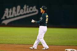 June 28, 2011; Oakland, CA, USA; Oakland Athletics designated hitter Hideki Matsui (55) rounds second base after hitting a double against the Florida Marlins during the second inning at the O.co Coliseum.  Oakland defeated Florida 1-0.