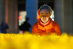 © Licensed to London News Pictures. 02/03/2017. London, UK. Members of the public view The Garden of Light, comprising 2,100 daffodils, which is currently on display in Paternoster Square next to St. Paul's Cathedral.  Each daffodil represents a Marie Curie Nurse, symbolising the care and support they give to families affected by terminal illness.  As part of the Great Daffodil charity, the display will be moved to other locations in the UK during March. Photo credit : Stephen Chung/LNP