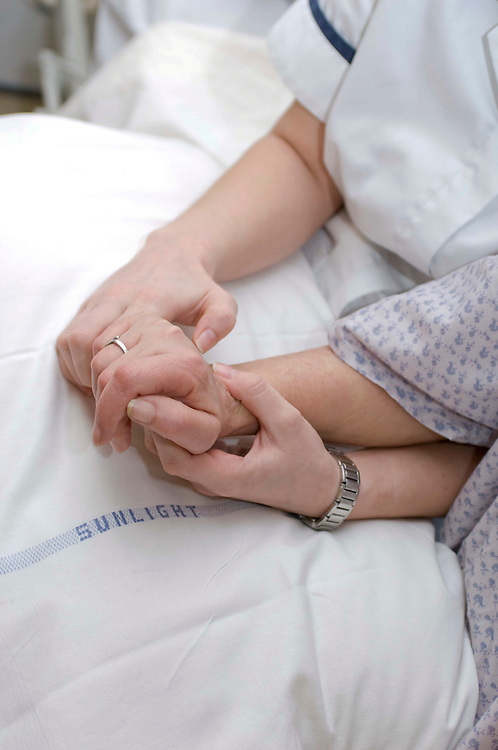 Physiotherapy on a patient's hand in hospital