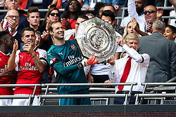 Petr Cech and Arsenal manager Arsene Wenger lift the Community Shield as their side celebrate after winning the penalty shootout - Rogan Thomson/JMP - 06/08/2017 - FOOTBALL - Wembley Stadium - London, England - Arsenal v Chelsea - FA Community Shield.
