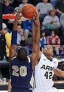 Navy's Carlton Smith (#20, left) misses a dunk over Army's Jordan Springer (#42, right) during the first half of their game in Christl Arena at the United States Military Academy in West Point, NY on Saturday, February 11, 2012. Springer had 4 points as Army defeated Navy 69 - 63 in double overtime.