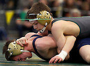 Dane Heberlein of Alexander, right, and Joe Sliwoski of Wayne compete in the 99-pound Division 2 championship match at the Section V State Qualifier in Brockport on Saturday, February 15, 2014.