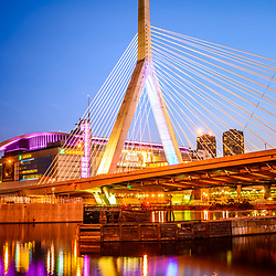 Boston Zakim Bunker Hill Bridge at night photo. The Leonard P. Zakim Bunker Hill Memorial Bridge is a cable bridge that spans the Charles River in Boston, Massachusetts in the United States.