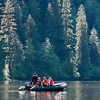 Guests on an inflatable zodiac boat in Rudyerd Bay in the Misty Fjords National Monument, Alaska.