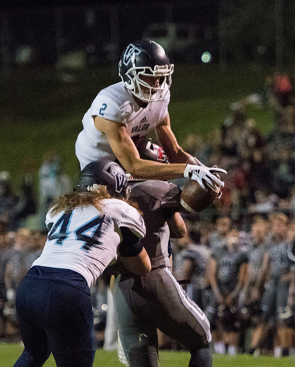 ARVADA - SEPT. 22: Valor Christian's Luke McCaffrey leaps to haul in a pass over Pomona's Santos Maguina, right, and McCaffrey's teammate Hunter Carlson during the first half of a Class 5A nonconference high school varsity football game held at the North Area Athletic Complex. (Photo by Andy Colwell/ Special to The Denver Post)