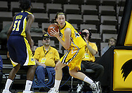 26 JANUARY 2009: Iowa center Megan Skouby (44) looks for someone to pass the ball to after a rebound during the first half of an NCAA women's college basketball game Monday, Jan. 26, 2009, at Carver-Hawkeye Arena in Iowa City, Iowa. Iowa defeated Michigan 77-69.