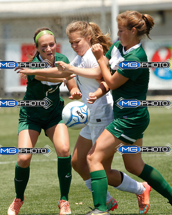 May 10, 2014; Huntsville, AL, USA; Oak Mountain Allison Elaine Nix (8) tries to keep the ball away from Mountain Brook Ansley Joy Peacock and Leigh Haynes (11) during the 6A State Girls Soccer Championship at John Hunt Soccer Complex. Mandatory Credit: Marvin Gentry